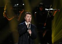 British soul-pop artist Sam Smith performs during the 42nd American Music Awards in Los Angeles, California in this November 23, 2014 file photo. REUTERS/Mario Anzuoni/Files