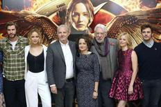 Cast members Liam Hemsworth, Jennifer Lawrence, director Francis Lawrence, producer Nina Jacobson, cast members Donald Sutherland, Elizabeth Banks and Sam Claflin, attend the photocall for 'The Hunger Games: Mockingjay Part 1', in London, November 9, 2014.  REUTERS/Paul Hackett