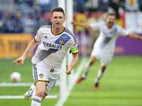 Los Angeles Galaxy forward Robbie Keane (7) celebrates after scoring a goal against the New England Revolution in the overtime during the 2014 MLS Cup final at Stubhub Center. Mandatory Credit: Gary A. Vasquez-USA TODAY Sports