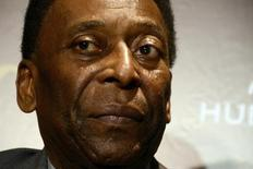 Brazilian soccer legend Pele looks on during a news conference after attending the inauguration of the first store in Brazil of Swiss watch maker Hublot in Rio de Janeiro, February 5, 2014. REUTERS/Lucas Landau