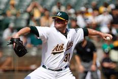 Sep 24, 2014; Oakland, CA, USA; Oakland Athletics starting pitcher Jon Lester (31) pitches the ball against the Los Angeles Angels during the first inning at O.co Coliseum. Kelley L Cox-USA TODAY Sports