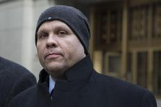 George Perez, a computer programmer for Bernard L. Madoff Investment Securities LLC, exits the Manhattan Federal Court house in New York, March 24, 2014. REUTERS/Andrew Kelly