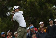 Australia's Adam Scott tees off on the fourth hole during the first round of the Australian Open golf tournament in Sydney, November 27, 2014.    REUTERS/Jason Reed