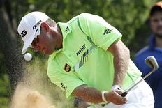 Former world number one Lee Westwood of Britain hits out of a bunker on the 13th hole during the Sun City Challenge golf tournament in Sun City December 6, 2014. REUTERS/Siphiwe Sibeko