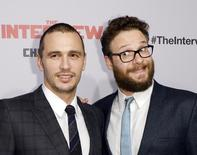 "Cast members James Franco (L) and Seth Rogen pose during premiere of the film ""The Interview"" in Los Angeles, California December 11, 2014.  REUTERS/Kevork Djansezian"