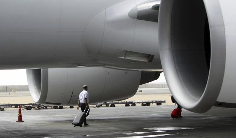 An EgyptAir airline crew member walks near an EgyptAir plane on the runway at Cairo Airport, September 5, 2013. REUTERS/Mohamed Abd El Ghany