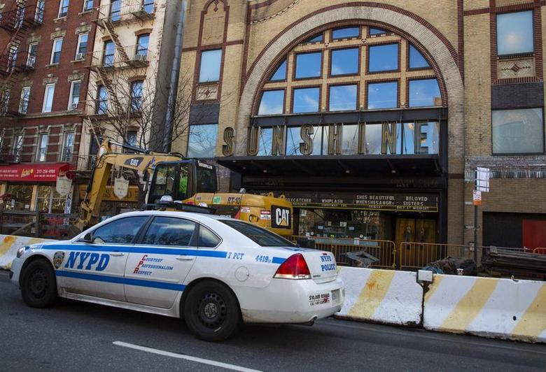 A New York City Police Department (NYPD) vehicle drives by the Sunshine Cinema in New York December 17, 2014. REUTERS/Andrew Kelly
