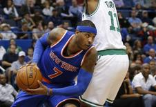 Oct 8, 2014; Hartford, CT, USA; New York Knicks forward Carmelo Anthony (7) works the ball against Boston Celtics guard Evan Turner (11) in the first half at XL Center. David Butler II-USA TODAY Sports