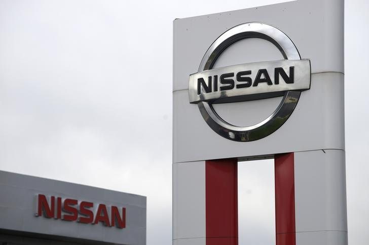 Nissan signs are seen outside a Nissan auto dealer in Broomfield, Colorado October 1, 2014. REUTERS/Rick Wilking