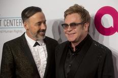 David Furnish (L) and Sir Elton John attend the Elton John AIDS Foundation's 13th annual An Enduring Vision Benefit in New York October 28, 2014. REUTERS/Andrew Kelly