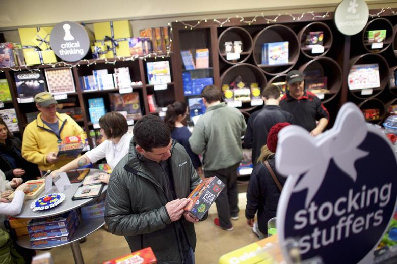 Shoppers browse at Marbles: The Brain Store within The Court, King of Prussia Mall, United State's largest retail shopping space, in King of Prussia, Pennsylvania in this file photo taken December 6, 2014. REUTERS/Mark Makela/Files