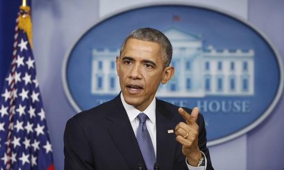 U.S. President Barack Obama answers a question after his end of the year press conference in the briefing room of the White House in Washington, December 19, 2014. REUTERS/Larry Downing