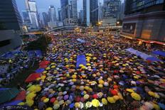 Protesters open their umbrellas, symbols of pro-democracy movement, as they mark exactly one month since they took the streets in Hong Kong's financial central district in this October 28, 2014 file photo. REUTERS/Damir Sagolj/Files