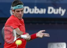Juan Martin Del Potro of Argentina returns the ball to Somdev Devvarman of India during their men's singles match at the ATP Dubai Tennis Championships February 25, 2014. REUTERS/Faisal Al Nasser