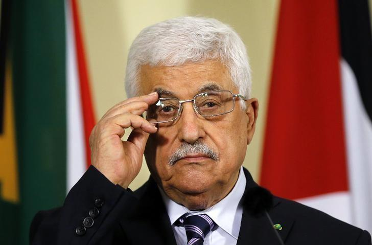 Palestinian President Mahmoud Abbas listens to a question during a media briefing at the Union Building in Pretoria November 26, 2014. REUTERS/Siphiwe Sibeko
