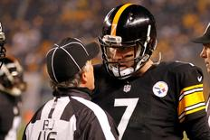 Jan 3, 2015; Pittsburgh, PA, USA; Pittsburgh Steelers quarterback Ben Roethlisberger (7) argues with back judge Perry Paganelli (46) after a play against the Baltimore Ravens in the third quarter in the 2014 AFC Wild Card playoff football game at Heinz Field. The Ravens won 30-17. Geoff Burke-USA TODAY Sports