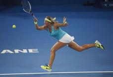 Victoria Azarenka of Belarus reaches for a baseline return during her women's singles match against Karolina Pliskova of the Czech Republic at the Brisbane International tennis tournament in Brisbane, January 5, 2015.    REUTERS/Jason Reed