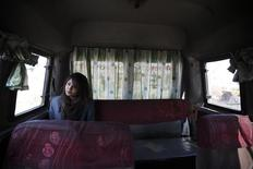A woman rides a women-only bus as she returns from her college in Kathmandu January 6, 2015.  REUTERS/Navesh Chitrakar