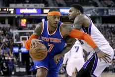 Dec 27, 2014; Sacramento, CA, USA; New York Knicks forward Carmelo Anthony (7) dribbles the ball around Sacramento Kings forward Rudy Gay (8) in the first quarter at Sleep Train Arena. Mandatory Credit: Cary Edmondson-USA TODAY Sports - RTR4JE8W