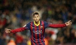 Barcelona's Neymar celebrates his second goal against Celta de Vigo during  La Liga's soccer match at Nou Camp stadium in Barcelona March 26, 2014.  REUTERS/Gustau Nacarino