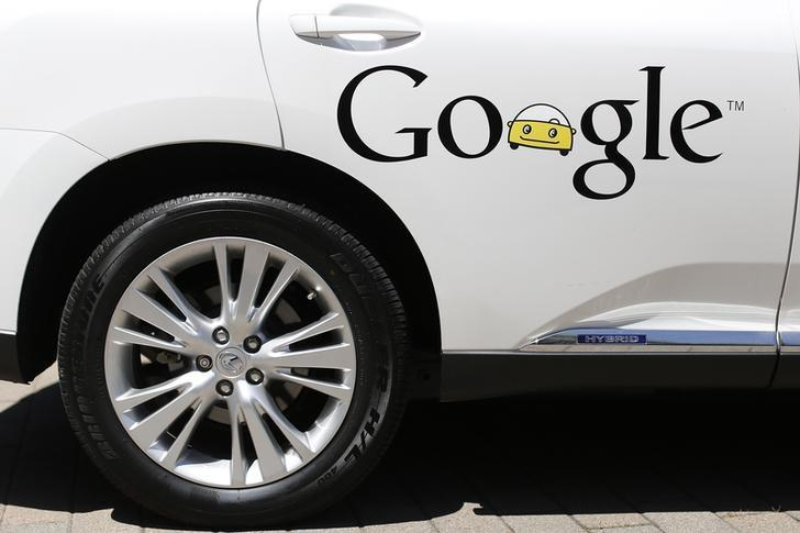 A Google self-driving vehicle is parked at the Computer History Museum after a presentation in Mountain View, California May 13, 2014. REUTERS/Stephen Lam