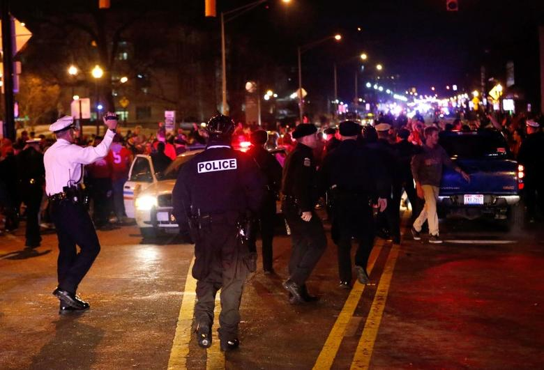 Jan 12, 2015; Columbus, OH, USA; Columbus Police walk the streets as Ohio State Buckeyes fans celebrate after the victory over the Oregon Ducks in the 2015 College Football Playoff National Championship game. Aaron Doster-USA TODAY Sports