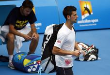 Serbia's Novak Djokovic (R) walks past Switzerland's Stan Wawrinka after they had a practice session together on Margaret Court Arena at Melbourne Park January 15, 2015. The Australian Open tennis tournament begins on January 19.   REUTERS/David Gray