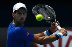 Serbia's Novak Djokovic hits a shot during a practice session at the Rod Laver Arena in Melbourne Park January 16, 2015.  REUTERS/David Gray