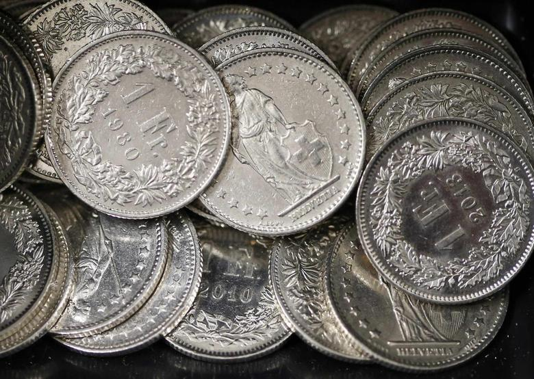 One Swiss franc coins are seen in a cash drawer in Bern January 16, 2015. REUTERS/Thomas Hodel