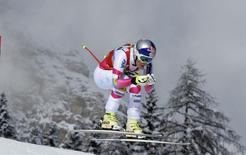 Lindsey Vonn of the U.S. is airborne as she clears a gate to win the women's World Cup Downhill skiing race in Cortina D'Ampezzo January 18, 2015. REUTERS/Stringer