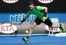 Andy Murray of Britain runs to hit a return to Marinko Matosevic of Australia during their men's singles second round match at the Australian Open 2015 tennis tournament in Melbourne January 21, 2015. REUTERS/Issei Kato
