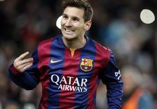 Lionel Messi comemora gol na vitória do Barcelona por 1 x 0 sobre o Atlético de Madri na Copa do Rei. 21/01/2015 REUTERS/Gustau Nacarino