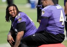 Baltimore Ravens nose tackle Terrence Cody (92) warms up during the NFL's Super Bowl XLVII football practice in Metairie, Louisiana February 1, 2013.REUTERS/Sean Gardner