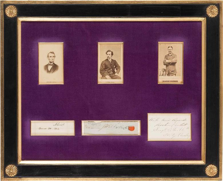A frame with six windows that contain Carte-de-Visites and autographs of Abraham Lincoln, John Wilkes Booth and Boston Corbett, part of the Dow Collection of Abraham Lincoln, is pictured in this undated handout photo provided by Heritage Auctions. REUTERS/Heritage Auctions/Handout via Reuters