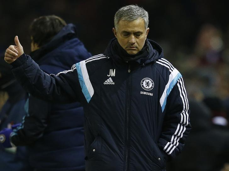 Chelsea's manager Jose Mourinho gestures after their English League Cup semi-final first leg soccer match against Liverpool at Anfield in Liverpool, northern England January 20, 2015. REUTERS/Phil Noble