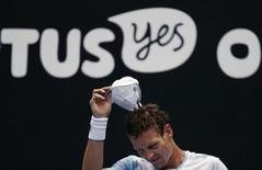 Tomas Berdych of Czech Republic reacts as he sits down during his men's singles fourth round match against Bernard Tomic of Australia at the Australian Open 2015 tennis tournament in Melbourne January 25, 2015. REUTERS/Thomas Peter