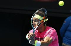 Rafael Nadal of Spain hits a return to Kevin Anderson of South Africa during their men's singles fourth round match at the Australian Open 2015 tennis tournament in Melbourne January 25, 2015. REUTERS/Athit Perawongmetha