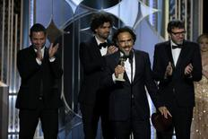 "Director and writer Alejandro Gonzalez Inarritu of Mexico (2nd R) accepts the Golden Globe Award for Best Screenplay - Motion Picture for ""Birdman"" at the 72nd Golden Globe Awards in Beverly Hills, California January 11, 2015.  REUTERS/Paul Drinkwater/NBC/Handout"