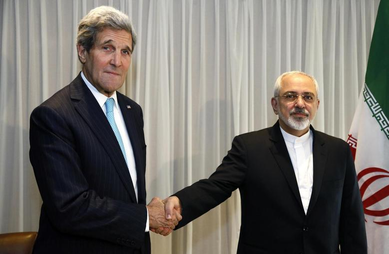 U.S. Secretary of State John Kerry shakes hands with Iranian Foreign Minister Mohammad Javad Zarif before a meeting in Geneva January 14, 2015.  REUTERS/Rick Wilking