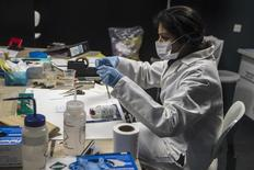 A forensic scientist analyzes samples in the DNA and Serology department at Punjab Forensic Science Agency in Lahore January 13, 2015. REUTERS/Zohra Bensemra