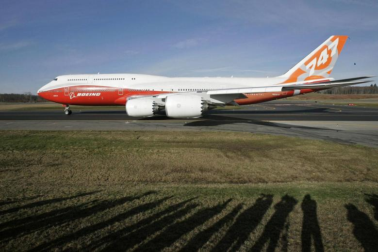 The Boeing 747-8 Intercontinental taxis down the runway before its maiden flight from Paine Field, in Everett, Washington, in this file photo taken March 20, 2011.   REUTERS/Robert Sorbo