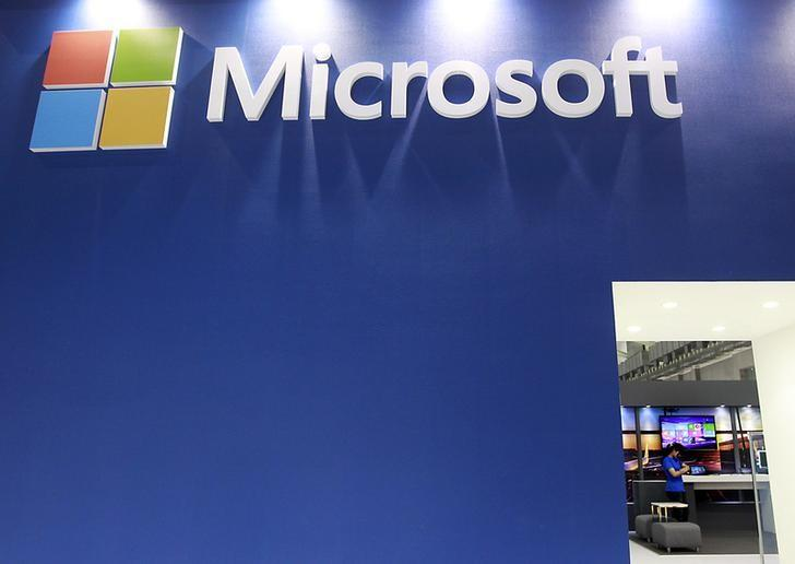 A employee stands in the Microsoft booth during the 2014 Computex exhibition at the TWTC Nangang exhibition hall in Taipei June 3, 2014.   REUTERS/Pichi Chuang/Files