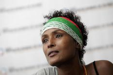 Human rights activist and top model Waris Dirie from Somalia attends a news conference during the 4th World Meeting of Human Values and Culture of Lawfulness at the Banamex auditorium in Monterrey October 26, 2012.  REUTERS/Daniel Becerril