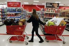 "A woman pulls shopping carts through the aisle of a Target store on the shopping day dubbed ""Black Friday"" in Torrington, Connecticut November 25, 2011.  REUTERS/Jessica Rinaldi"
