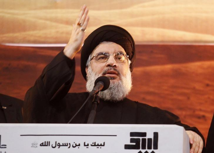 Lebanon's Hezbollah leader Sayyed Hassan Nasrallah addresses his supporters during a rare public appearance at an Ashoura ceremony in Beirut's southern suburbs November 3, 2014. REUTERS/Khalil Hassan/Files
