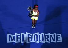 Serena Williams poses with her trophy after defeating Maria Sharapova of Russia in their women's singles final match at the Australian Open 2015 tennis tournament in Melbourne January 31, 2015.  REUTERS/Carlos Barria