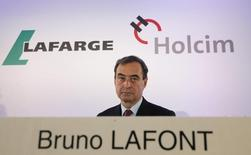 Lafarge CEO Bruno Lafont, who will become CEO of LafargeHolcim, attends a news conference in Paris, April 7, 2014. REUTERS/Christian Hartmann
