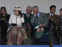 Britain's Queen Elizabeth (front L) and Prince Charles (front R) watch the sack race at the annual Braemar Highland Gathering in Braemar, Scotland September 6, 2014.   REUTERS/Russell Cheyne