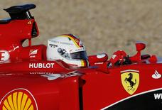 Ferrari Formula One racing driver Sebastian Vettel of Germany drives the new Ferrari SF15T car during pre-season testing at the Jerez racetrack in southern Spain February 1, 2015.   REUTERS/Marcelo del Pozo