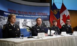 (L to R) Assistant Superintendent Joan McKenna, Ottawa Police Services; Assistant Commissioner James Malizia, RCMP Federal Policing Operations; Chief Superintendent Jennifer Strachan, RCMP Criminal Operations Office, and Deputy Commissioner Scott Tod, Ontario Provincial Police,  listen to reporters' questions at RCMP headquarters after announcing terror-related charges have been laid against three men in Ottawa, February 3, 2015.  REUTERS/Patrick Doyle